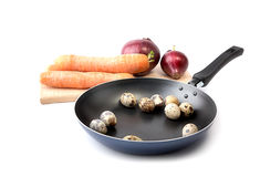 Carrots, onions  and quail eggs isolated Stock Photography