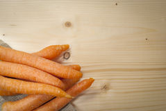 Carrots over natural wood. And hempt Stock Images