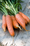Carrots over the old aged wood table in the garden Royalty Free Stock Photos