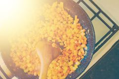 Carrots on the pan. Chopped carrots frying on the pan. Healthy eating and lifestyle. Food background stock image