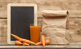 Carrots with paper bag Stock Image