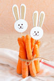 Carrots and paper rabbits Stock Photo