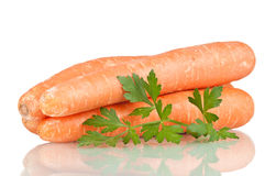 Carrots. And parsley over white reflective background Royalty Free Stock Photos