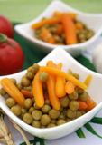 Carrots and peas Stock Images