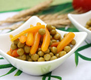 Carrots and peas Stock Photos