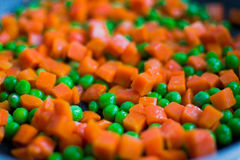 Carrots and peas  Royalty Free Stock Images