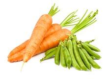 Carrots and peas pod Stock Photo