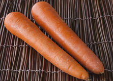 Carrots. Placed on wooden mat Stock Photos