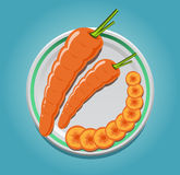 Carrots on a plate with slices Royalty Free Stock Image