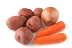 Carrots, potatoes and onion on white background Royalty Free Stock Images