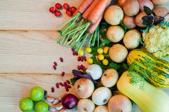 Carrots, potatoes, onions and other vegetables on wooden table. Vegetables. Carrots, potatoes, onions and other vegetables on wooden table Stock Photos