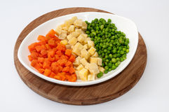 Carrots, potatoes and peas prepared for the Russian salad Stock Images