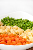 Carrots, potatoes and peas prepared for the Russian salad Royalty Free Stock Images