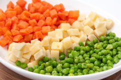 Carrots, potatoes and peas prepared for the Russian salad Royalty Free Stock Photography