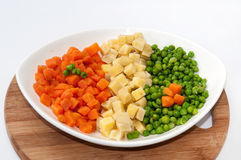 Carrots, potatoes and peas prepared for the Russian salad Stock Photos