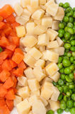 Carrots, potatoes and peas prepared for the Russian salad Royalty Free Stock Photos