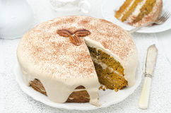 Carrots and pumpkin cake with coffee cream in a cut horizontal Royalty Free Stock Photos