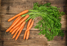 Carrots on rustic wooden background. Country style food concept Royalty Free Stock Image