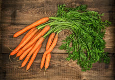 Carrots on rustic wooden background. Country style food concept Stock Photography