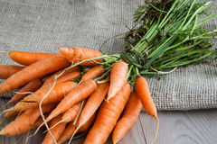 Carrots on sack Royalty Free Stock Images