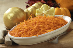 Carrots  salad in a tray with lemon. And pumpkins Stock Images