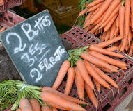 Carrots for sale on market stall Royalty Free Stock Photo