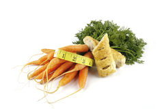 Carrots and Sausage Roll with Tape Measure Stock Photography