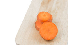 Carrots slice on cutting board on white background. Royalty Free Stock Photography