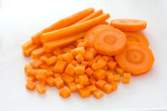 Carrots sliced and diced. In three different ways on a white background stock photo