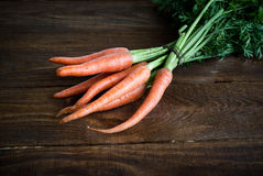 Carrots. Some fresh carrots at the wooden table Stock Photo