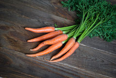 Carrots. Some fresh carrots at the wooden table Stock Photography