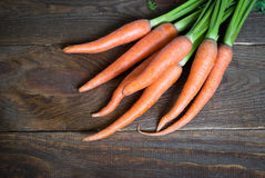 Carrots. Some fresh carrots at the wooden table Stock Photos