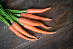 Carrots. Some fresh carrots at the wooden table Stock Images