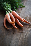 Carrots. Some fresh carrots at the wooden table Stock Image
