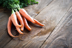 Carrots. Some fresh carrots at the wooden table Royalty Free Stock Images