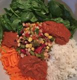 Carrots spinach rice mixed beans hot sauce ready for wraps stock image