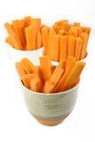 Carrots sticks on white background Stock Photos
