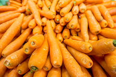 The carrots on the supermarket display Stock Image