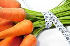 Carrots with tape measure Royalty Free Stock Photos
