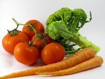 Carrots tomatoes and broccoli Stock Images