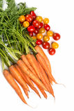 Carrots and tomatoes. A bunch carrots and tomatoes Royalty Free Stock Photography