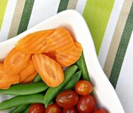 Carrots, Tomatoes and Sugar Snap Peas Royalty Free Stock Images