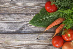 Carrots and tomatoes. On the table Stock Images