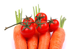 The carrots and tomatoes on white Royalty Free Stock Image