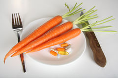 Carrots and vitamins Royalty Free Stock Images