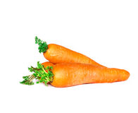 Carrots on white. Fabric background Royalty Free Stock Photos