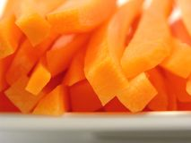 Carrots on a white plate Royalty Free Stock Image