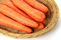 Carrots in wicker basket Stock Image