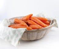 Carrots in wicker basket Stock Photography