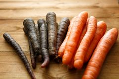 Carrots on wood. Carrots on the wooden background Stock Photos